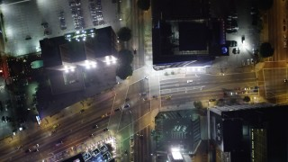 DCA01_037 - 5K stock footage aerial video bird's eye view following South Figueroa Street at night, Downtown Los Angeles, California