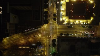 DCA01_039 - 5K stock footage aerial video bird's eye view following South Figueroa Street in Downtown Los Angeles at night, California