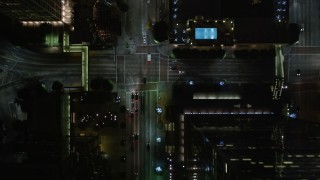 DCA01_040E - 5K stock footage aerial video bird's eye view following South Figueroa Street in Downtown Los Angeles at night, California
