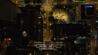 DCA01_044 - 5K stock footage aerial video bird's eye view of Los Angeles Public Library, South Hope Street, at night California