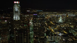 DCA01_053 - 5K stock footage aerial video flying by skyscrapers in Downtown Los Angeles at night, California