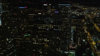 DCA01_053E - 5K stock footage aerial video flying by and orbiting skyscrapers in Downtown Los Angeles at night, California
