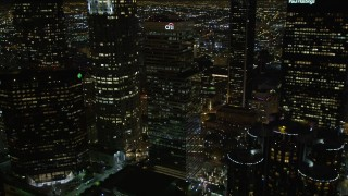 DCA01_055 - 5K stock footage aerial video flying by skyscrapers and public library in downtown Los Angeles at night, California