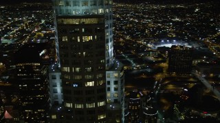 DCA01_056 - 5K stock footage aerial video flying by skyscrapers and buildings in Downtown Los Angeles at night, California