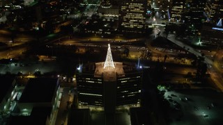 DCA01_059 - 5K stock footage aerial video orbiting Christmas tree made of lights in Downtown Los Angeles at night, California