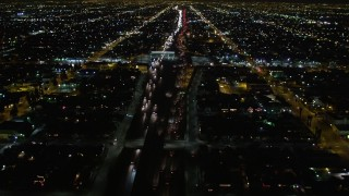 DCA01_062 - 5K stock footage aerial video following Highway 110 in Los Angeles at night, California