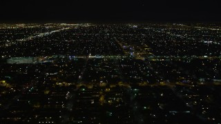 DCA01_064 - 5K stock footage aerial video flying by a residential neighborhood at night, Los Angeles, California