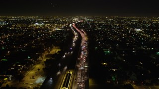 DCA01_069 - 5K stock footage aerial video following I-105 passing through city lights at night, Hawthorne, California