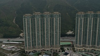 DCA02_004 - 4K stock footage aerial video flyby Caribbean Coast apartment complex in Tung Chung, Lantau Island, Hong Kong, China