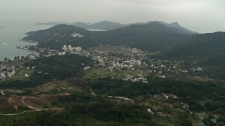 DCA02_005 - 4K stock footage aerial video of the small coastal town of Mui Wo on Lantau Island, Hong Kong, China