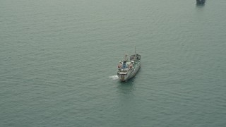 DCA02_008 - 4K stock footage aerial video of a cargo ship on the South China Sea near the Outlying Islands, Hong Kong, China