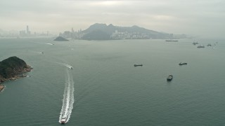 DCA02_009 - 4K stock footage aerial video approach ferries and cargo ships near Hong Kong Island and Victoria Harbor, China