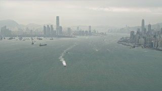 DCA02_013 - 4K stock footage aerial video of ships sailing Victoria Harbor near Kowloon, Hong Kong, China