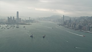 DCA02_014 - 4K stock footage aerial video of ships sailing Victoria Harbor between Kowloon and Hong Kong Island, China