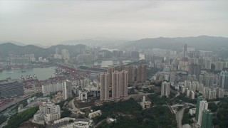 DCA02_019 - 4K stock footage aerial video pan from Rambler Channel across Kwai Chung apartment complexes, Hong Kong, China