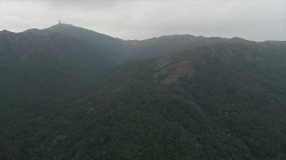 DCA02_024 - 4K stock footage aerial video of green mountains in the New Territories, Hong Kong, China