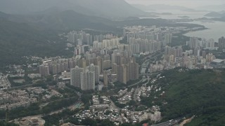 DCA02_028 - 4K stock footage aerial video of apartment buildings in in Tai Po in the New Territories, Hong Kong, China