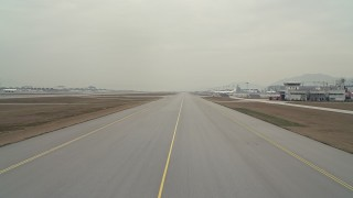 DCA02_034 - 4K stock footage aerial video of lifting off from a runway at Hong Kong International Airport, China
