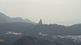 DCA02_039 - 4K stock footage aerial video of Tian Tan Buddha statue on Lantau Island, Hong Kong, China