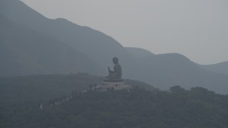 DCA02_040 - 4K stock footage aerial video orbit the Tian Tan Buddha statue on Lantau Island, Hong Kong, China