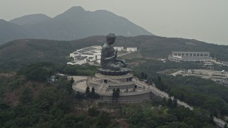 DCA02_042 - 4K stock footage aerial video of an orbit around the Tian Tan Buddha statue on Lantau Island, Hong Kong, China