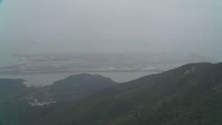 DCA02_045 - 4K stock footage aerial video approach Hong Kong International Airport from  Lantau Island, Hong Kong, China