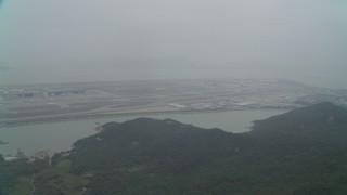 DCA02_046 - 4K stock footage aerial video pan across Hong Kong International Airport, Hong Kong, China