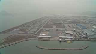 DCA02_049 - 4K stock footage aerial video of maintenance buildings and runways at Hong Kong International Airport, Hong Kong, China