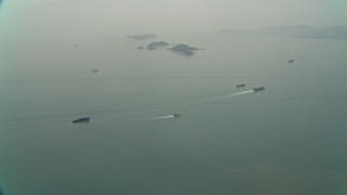 DCA02_050 - Aerial stock footage of Oil slick and barges near Sha Chau Island in the South China Sea, New Territories, Hong Kong, China