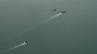 DCA02_051 - Aerial stock footage of Fly over barges near Sha Chau Island in the South China Sea, New Territories, Hong Kong, China