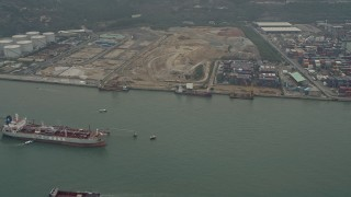 DCA02_055 - 4K stock footage aerial video of oil tanker near cargo containers at Pillar Point port, New Territories, Hong Kong, China