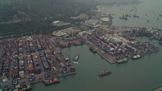 DCA02_056 - 4K stock footage aerial video of barges and cargo containers at Pillar Point port, New Territories, Hong Kong, China