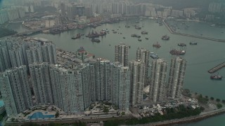 DCA02_059 - 4K stock footage aerial video of waterfront apartments high-rises and Castle Peak Bay in New Territories, Hong Kong, China