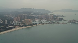 DCA02_060 - 4K stock footage aerial video of Hong Kong Gold Coast Hotel, marina, and waterfront apartment high-rises in New Territories, Hong Kong, China