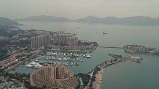 DCA02_061 - 4K stock footage aerial video flyby Hong Kong Gold Coast Hotel, marina, and waterfront apartment high-rises in New Territories, Hong Kong, China