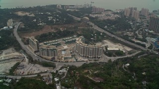 DCA02_063 - 4K stock footage aerial video of Avignon Tower apartment complex in New Territories, Hong Kong, China
