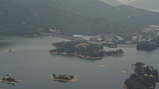 DCA02_065 - 4K stock footage aerial video of Tai Lam Chung Reservoir and dam in New Territories, Hong Kong, China
