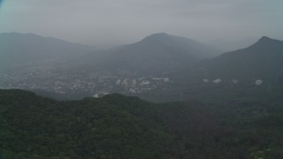 DCA02_070 - 4K stock footage aerial video flyby peak to reveal Shek Kong neighborhoods, New Territories, Hong Kong, China