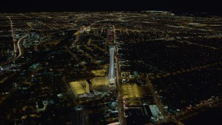DCA03_002 - 4K stock footage aerial video approaching Stratosphere with city sprawl in background, Las Vegas, Nevada Night