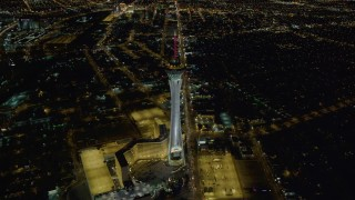 DCA03_003 - 4K aerial stock footage video of approaching Stratosphere, Las Vegas, Nevada Night