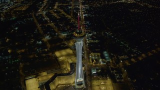 DCA03_004 - 4K stock footage aerial video of approaching top of Stratosphere, Las Vegas, Nevada Night