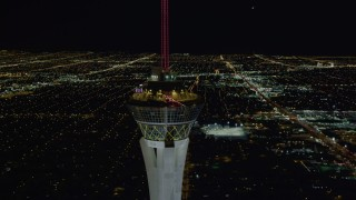 DCA03_007 - 4K stock footage aerial video of orbiting top of Stratosphere with city sprawl in background, Las Vegas, Nevada Night
