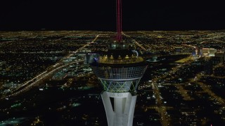 DCA03_008 - 4K stock footage aerial video of orbiting top of Stratosphere with city sprawl in background, Las Vegas, Nevada Night