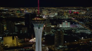 DCA03_010 - 4K stock footage aerial video of orbiting top of Stratosphere, revealing hotels along the strip, Las Vegas, Nevada Night