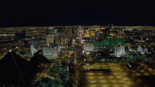 DCA03_014 - 4K stock footage aerial video of Las Vegas Boulevard, past Mandalay Bay, Excalibur, Luxor, Las Vegas, Nevada Night