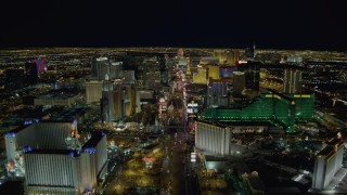 DCA03_015 - 4K stock footage aerial video of Las Vegas Boulevard past Excalibur, New York New York, MGM Grand, Las Vegas, Nevada Night
