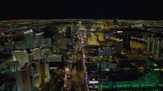 DCA03_016 - 4K stock footage aerial video of Las Vegas Boulevard between New York New York and MGM Grand to Monte Carlo, Las Vegas, Nevada Night