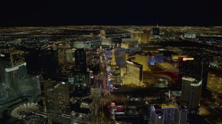 DCA03_017 - 4K stock footage aerial video of Las Vegas Boulevard past Aria to Planet Hollywood, Las Vegas, Nevada Night