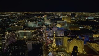 DCA03_018 - 4K stock footage aerial video of Las Vegas Boulevard past Planet Hollywood to Flamingo and Caesar's Palace, Las Vegas, Nevada Night