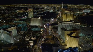DCA03_020 - 4K stock footage aerial video of Las Vegas Boulevard between The Mirage and The Venetian, toward Treasure Island, Las Vegas, Nevada Night
